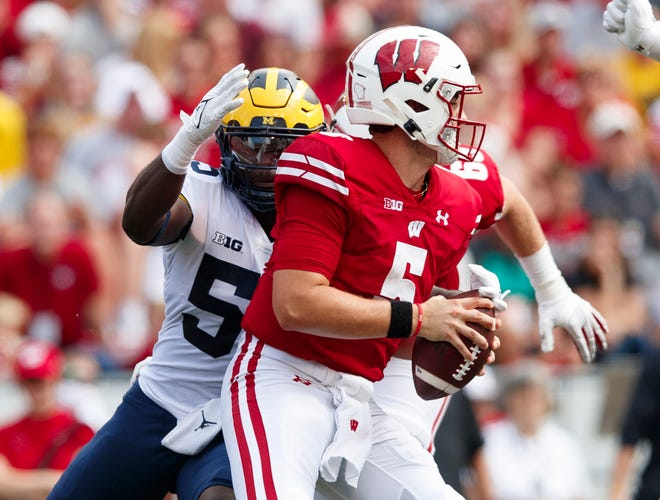 Wisconsin quarterback Graham Mertz is sacked by Michigan linebacker David Ojabo during the second quarter at Camp Randall Stadium. Mertz left the game in the third quarter with an injury.