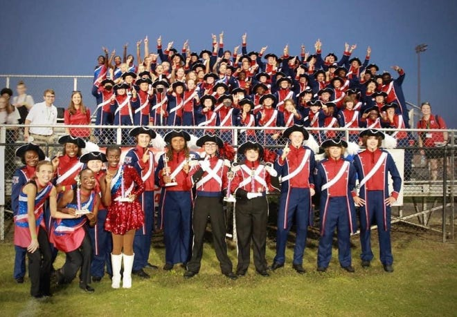 Members of the 96-strong Pike Road Patriot Marching Band celebrate an award-winning performance at the Camellia Marching Band Festival held in Marbury.