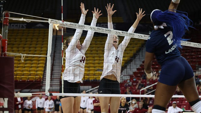 New Mexico State redshirt senior Lia Mosher blocks a point against Cal Baptist on Oct. 2, 2021.