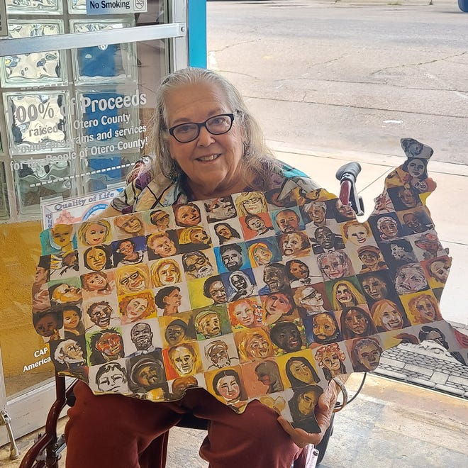 Kathy Hauge holding a masterpiece.