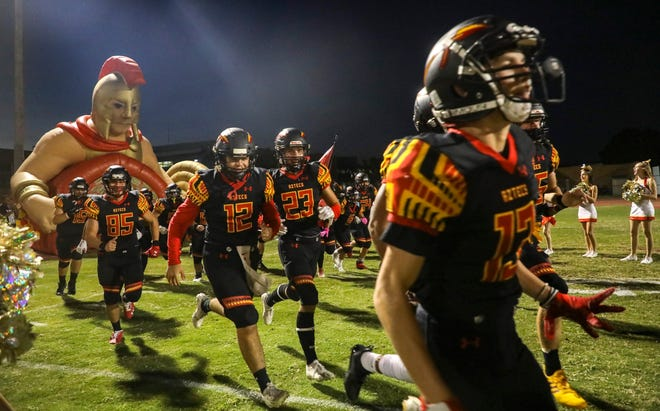 Palm Desert players take the field before their game at Palm Desert High School, Friday, Oct. 1, 2021, in Palm Desert, Calif.