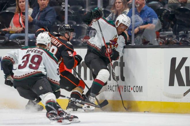 Arizona Coyotes forward Bokondji Imama (15) vie the puck against Anaheim Ducks defenseman Trevor Carrick (54) during the first period of an NHL hockey game Wednesday, Sept. 29, 2021, in Anaheim, Calif.