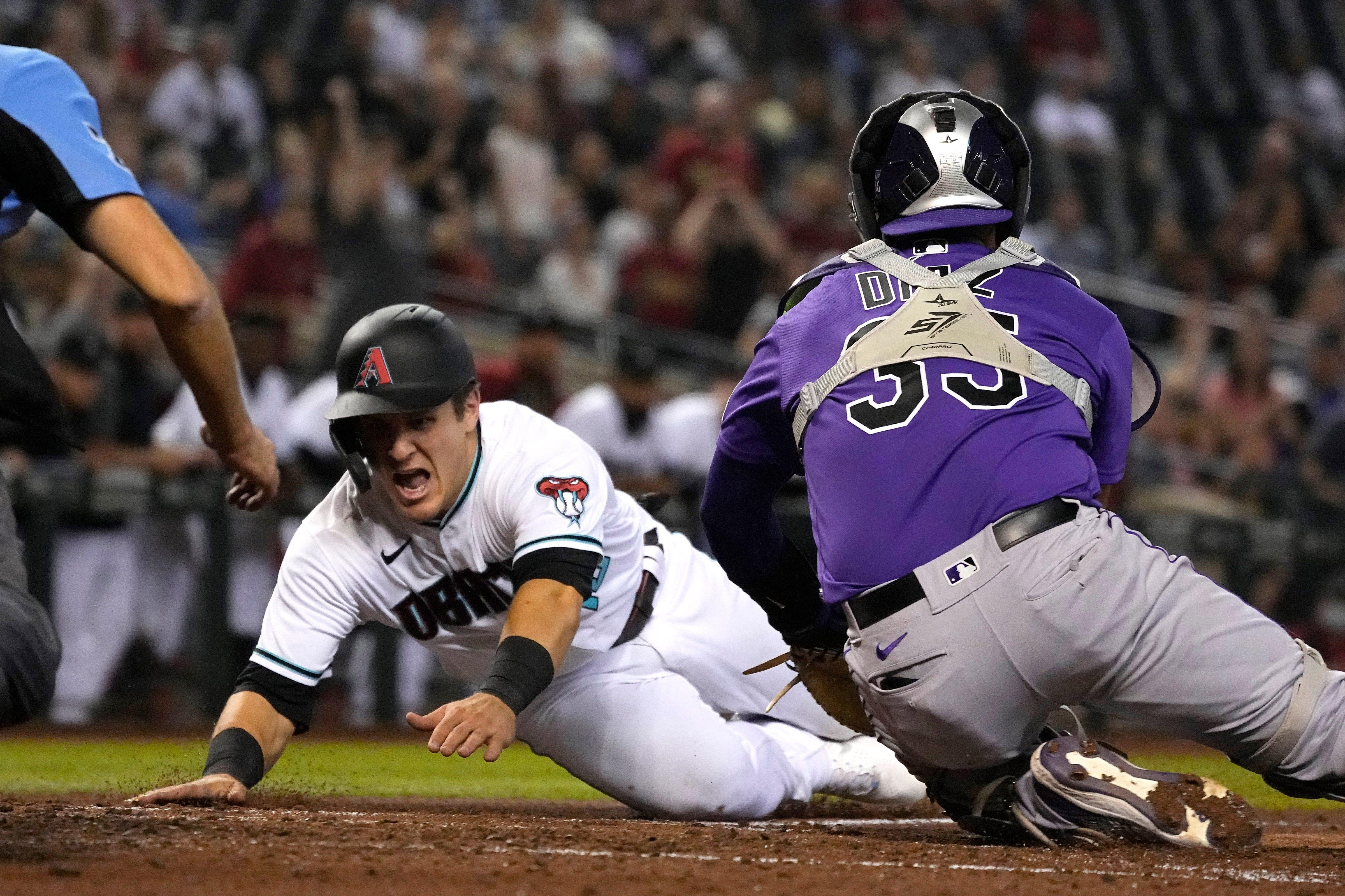 Pitcher homers, but Diamondbacks lose seven-run lead in loss to Rockies