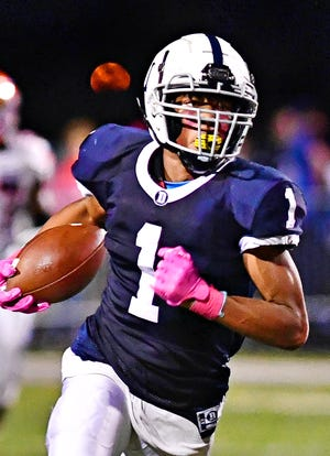 Dallastown's Kenny Johnson runs the ball during football action against York High at Dallastown Area High School in York Township, Friday, Oct. 1, 2021. York High would win the game 36-20. Dawn J. Sagert photo