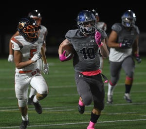 Damonte Ranch's Mason Reasoner runs for a touchdown against Douglas during last week's Northern 5A action.