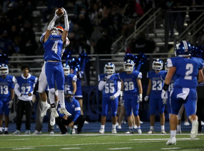 McNary's Gunner Smedema (4) intercepts a pass intended for Sprague's Drew Rodriguez (7) during the first half of the game on Friday, Oct. 1, 2021 in Keizer, Ore.