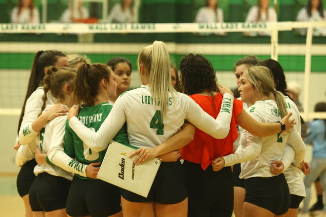 The Wall High School volleyball team huddles with their coach during a District 6-3A match Saturday, Oct. 2, 2021, in Wall.