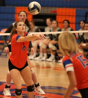 San Angelo Central's Laynee Crooks sets the ball during  a match against Odessa Permian at Babe Didrikson gym on Tuesday, Sept. 28, 2021.
