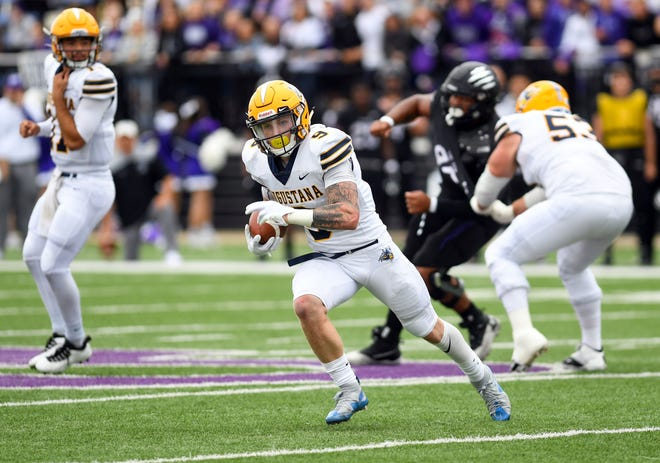 Augustana's Jarod Epperson runs the ball during a game against University of Sioux Falls on Saturday, October 2, 2021, at Bob Young Field.