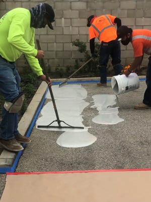 The Laborers' International Union of North America, Local 585, recently trained 10  union members to install Oxnard-manufactured ePAVE, a surface material for repairing cracked asphalt and extending pavement life.