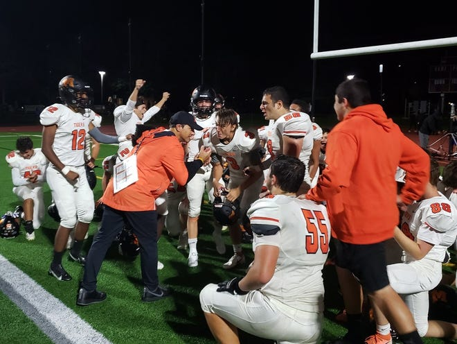 Mamaroneck coach Anthony Vitti addresses the team following their 24-21 win against Scarsdale on Oct. 1, 2021.