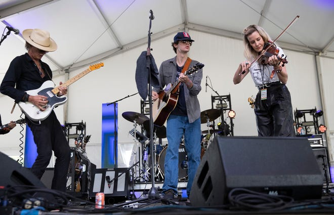 Calder Allen, middle, performs with Charlie Sexton, left, and Martie Maguire at the Austin City Limits Music Festival in Zilker Park on Sunday, Oct. 3, 2021.