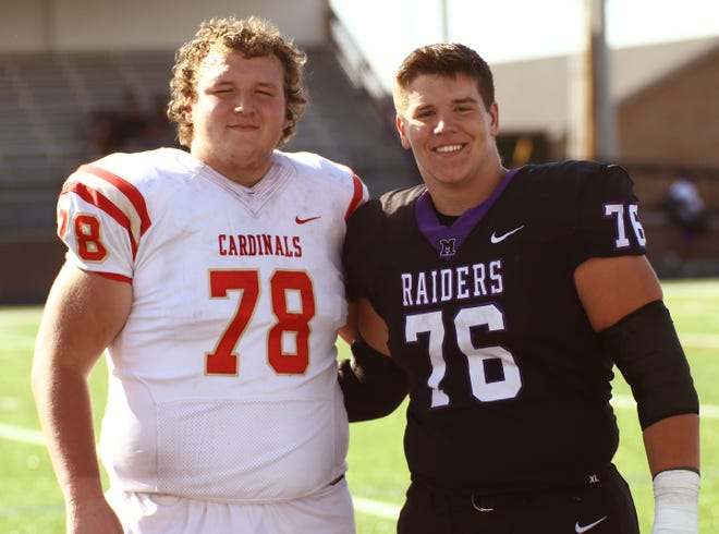 West Branch graduates Clayton Adams, left, playing for Otterbein and his cousin Max Craig, right, playing for Mount Union following the Otterbein-Mount Union game, Saturday, October 2, 2021.