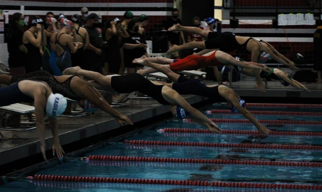 Swimmers dive into the pool for the opening leg of the 200-yard freestyle relay at the Monroe County Championship at Milan on Saturday, October 2, 2021.