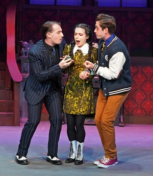 """Gomez (Matt Paris), Wednesday (Carly Kerr) and her """"normal"""" boyfriend Lucas (Jordan Burnett) share a moment together in Priscilla Beach Theatre's production of """"The Addams Family – A New Musical."""""""