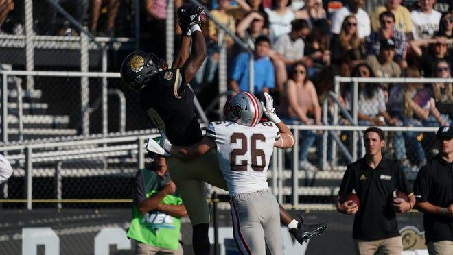 Bryant's David Zorilla makes a catch as Brown's Cooper Deveau defends on Saturday at Beirne Stadium in Smithfield.