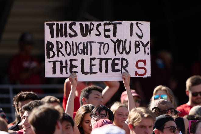 A Stanford fan holds up a sign during the second quarter against Oregon at Stanford Stadium. Stan Szeto-USA TODAY Sports