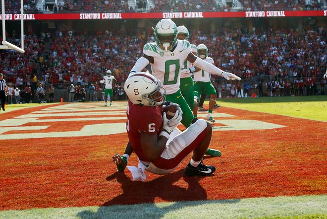 Stanford's Elijah Higgins catches a 2-yard touchdown pass in front of Oregon cornerback DJ James (0) on the final play of regulation Saturday to force overtime. The Cardinal went on to upset No. 3 Oregon 31-24 in overtime.
