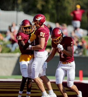 Northern State wide receiver Dewaylon Ingram, left, congratulates tight end Jacob Streit after he scored a touchdown at the end of the second quarter in Saturday's Gypsy Days game against UMary. American News photo by Jenna Ortiz, taken 10/02/2021.