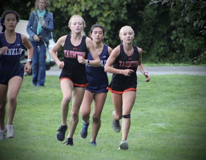 Taunton High cross country runner Emersyn DePonte , left, won the third race of her career to set a new school record for most individual wins