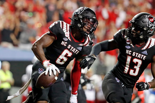 North Carolina State's Jakeen Harris (6) celebrates his interception with teammate Tyler Baker-Williams (13) as time runs out in an NCAA college football game against Louisiana Tech in Raleigh, N.C., Saturday, Oct. 2, 2021. (AP Photo/Karl B DeBlaker)