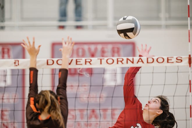 Taylor Luneborg spikes during game one of their triangular versus Meadowbrook, Saturday, Oct. 2 at Dover High School.