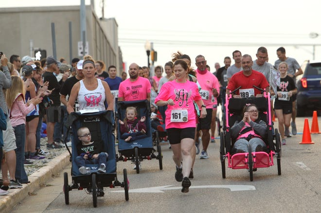 """The Ainsley Angel's group starts their portion of the Capital Half Marathon first. Ainsley Angels is an organization whose goal is to help everyone expereince endurance events. The website ainsleyangels.org states; """"Ainsley Angels of America aims to build awareness about America's special needs community through inclusion in all aspects of life. Serving as advocates to providing education and participating as active members in local communities, we believe everyone deserves to be included."""""""