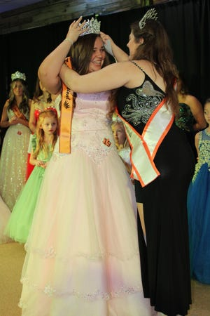The 2019 Fall Foliage Festival Queen Haley Seig crowns the 2021 Queen, Mariah LaLond.