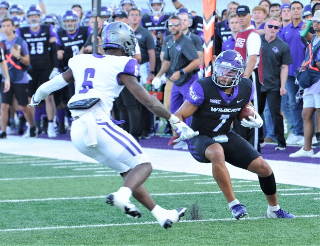 ACU receiver Alex Spadone, right, tries to get past Central Arkansas' Christian Cain. Spadone scored on the 36-yard pass play from Stone Earle for the game's first TD with 7:52 left in the first quarter. The Bears beat ACU 42-21 in the WAC/ASUN Challenge game Saturday, Oct. 2, 2021 at Wildcat Stadium.