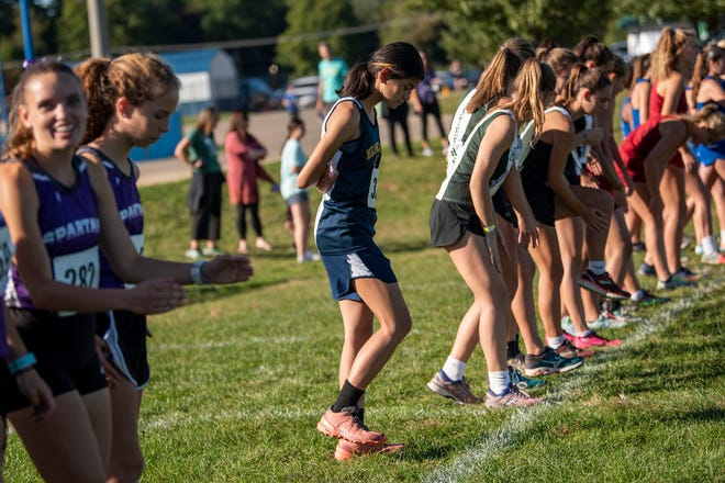 Battle Creek Central senior Bailey McCulloch competes in the All-City cross country meet on Tuesday, Sept. 28, 2021 at Harper Creek High School in Battle Creek, Michigan. McCulloch doesn't let the fact she is the only girl cross country runner at her school keep her from running.