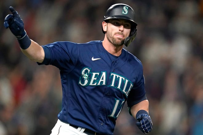 Seattle Mariners' Mitch Haniger motions toward his dugout as he begins to round the bases on his two-run home run against the Los Angeles Angels in the fifth inning of a baseball game Saturday, Oct. 2, 2021, in Seattle. (AP Photo/Elaine Thompson)