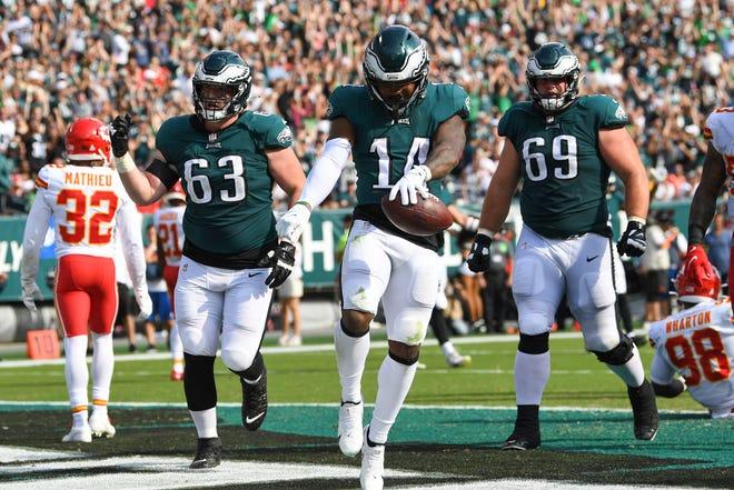 Philadelphia Eagles running back Kenneth Gainwell (14) celebrates fourth quarter touchdown during an NFL football game against the Kansas City Chiefs, Sunday, Oct. 3, 2021, in Philadelphia. (AP Photo/Terrance Williams)
