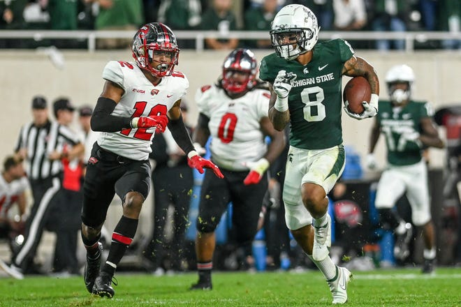 Michigan State's Jalen Nailor, right, catches a pass as Western Kentucky's Kahlef Hailassie closes in during the second quarter on Saturday, Oct. 2, 2021, at Spartan Stadium in East Lansing.