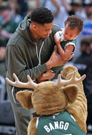 Giannis Antetokounmpo introduces his son Liam to mascot Bango during the Bucks' open scrimmage Sunday. Antetokounmpo didn't play in the scrimmage or Tuesday night's exhibition opener but did get back to five-on-five action Wednesday.