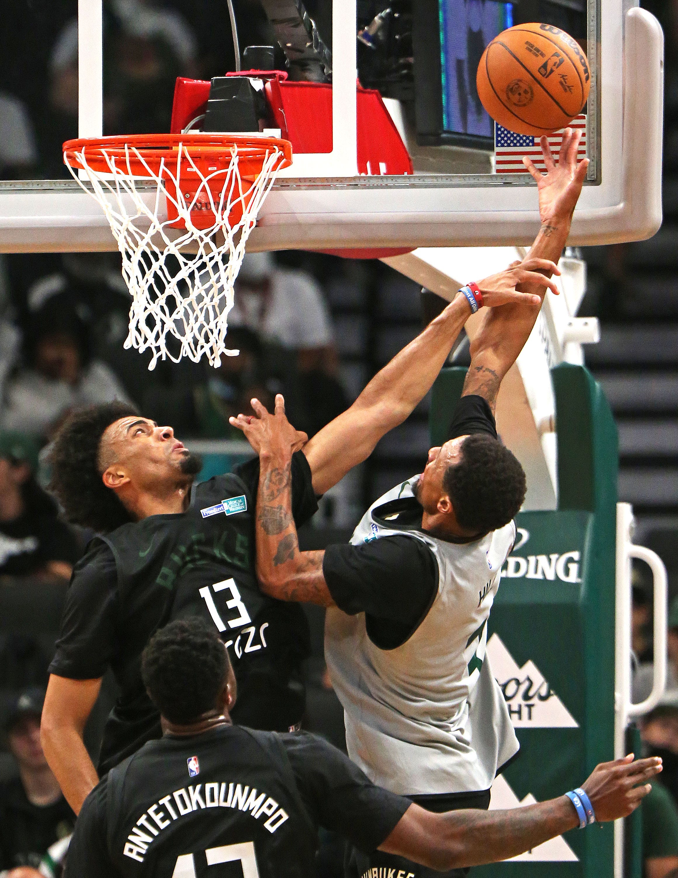 The Milwaukee Bucks got back to work in front of fans Sunday and set a competitive tone in their open scrimmage
