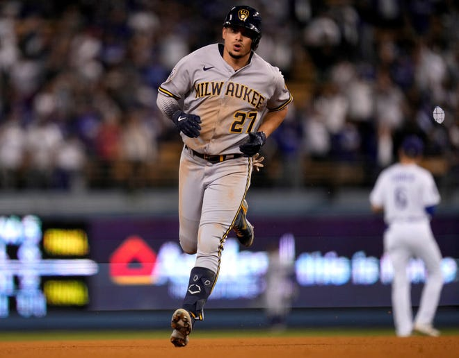 Oct 2, 2021; Los Angeles, California, USA; Milwaukee Brewers shortstop Willy Adames (27) rounds the bases after hitting a ninth inning home run against the Los Angeles Dodgers at Dodger Stadium. Mandatory Credit: Robert Hanashiro-USA TODAY Sports