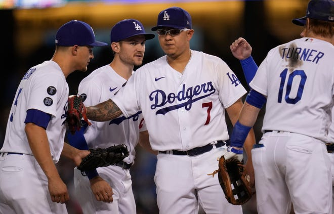 Dodgers starter Julio Urias bumps the chest of shortstop Corey Seager as Urias leaves the game against the Brewers in the seventh inning at Dodger Stadium. Urias was going for his Major League-leading 20th win of the season.