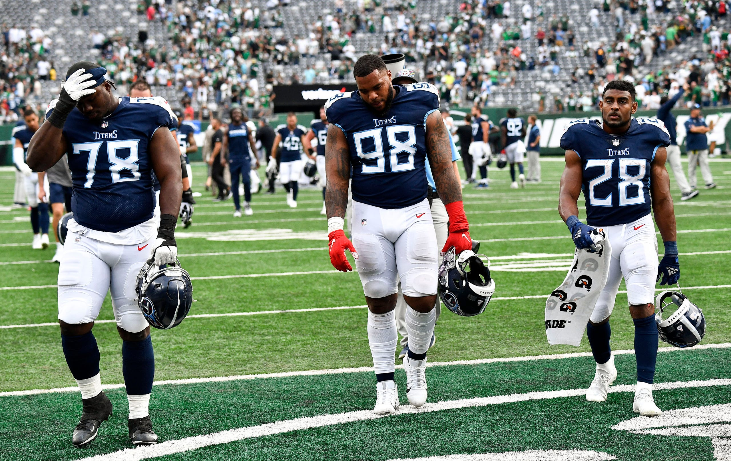 The Titans leave the field after losing to the Jets in overtime at MetLife Stadium Sunday, Oct. 3, 2021 in East Rutherford, N.J.