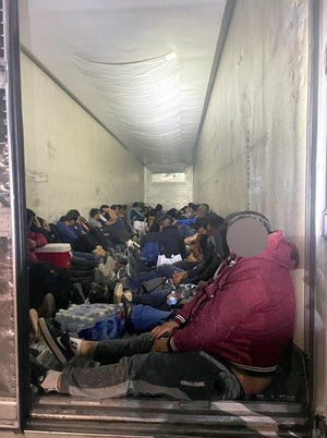Migrants were discovered huddled in the semi tractor trailer during an inspection at the I-25 Border Patrol immigration checkpoint in Las Cruces.