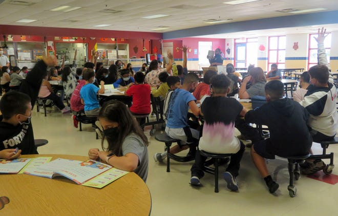 Bataan Elementary School fifth graders met in the school cafeteria with Deming Police Dept. Detective Britney Valdez to discuss the student involvement with the D.A.R.E. (Drug Abuse Resistance Education) program.