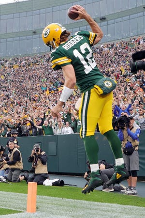 Green Bay Packers quarterback Aaron Rodgers celebrates after running for a touchdown during the second quarter against the Pittsburgh Steelers at Lambeau Field on Oct. 03, 2021 in Green Bay.