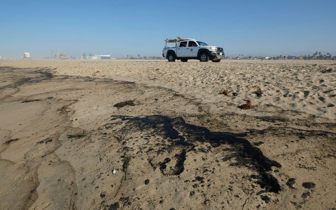 Oil washed up on Huntington Beach, Calif., on Sunday., Oct. 3, 2021. A major oil spill off the coast of Southern California fouled popular beaches and killed wildlife while crews scrambled Sunday, to contain the crude before it spread further into protected wetlands. (AP Photo/Ringo H.W. Chiu)