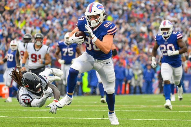 Oct 3, 2021; Orchard Park, New York, USA; Buffalo Bills tight end Dawson Knox (88) runs with the ball after a catch avoiding the tackle of Houston Texans cornerback Tavierre Thomas (37) during the first half at Highmark Stadium. Mandatory Credit: Rich Barnes-USA TODAY Sports