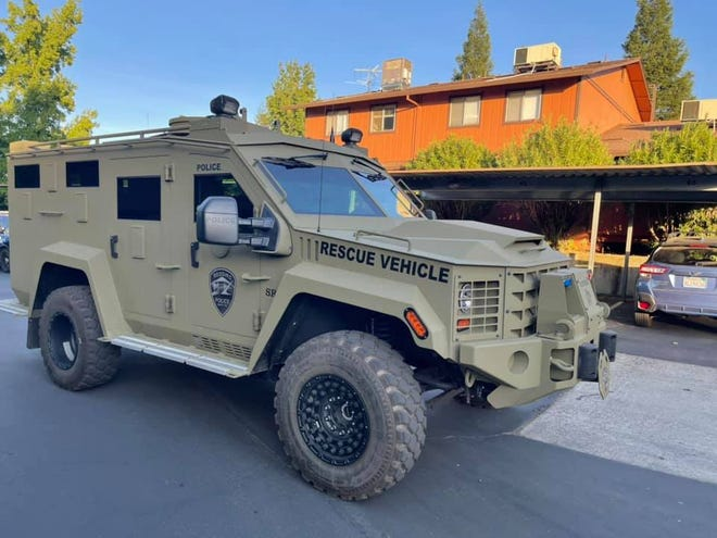Redding police brought out their olive-green Lenco BearCat armored rescue vehicle in response to reports of an armed man in north Redding on Satuday evening, Oct. 2, 2021.