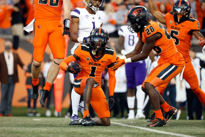 Oregon State Beavers defensive back Rejzohn Wright (1) celebrates after recovering a fumble against the Washington Huskies during the first half at Reser Stadium. USA TODAY Sports