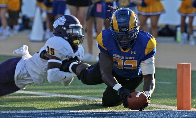 Nathaniel Omayebu III, right, reaches for the end zone for the Angelo State University Rams during a game against Western New Mexico on Saturday, Oct. 2, 2021.