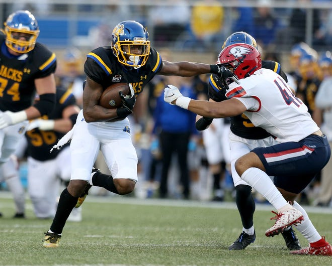 BROOKINGS, SD - OCTOBER 2: Pierre Strong, Jr. #20 from South Dakota State breaks loose for a 21 yard touchdown past Will Paden III #41 from Dixie State during their game at Dana J. Dykhouse Stadium in Brookings, SD. (Photo by Dave Eggen/Inertia)