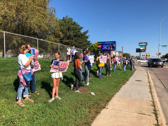 Demonstrators gather along 41st Street near O'Gorman High School to support an end of abortion on Sunday, October 3, 2021.