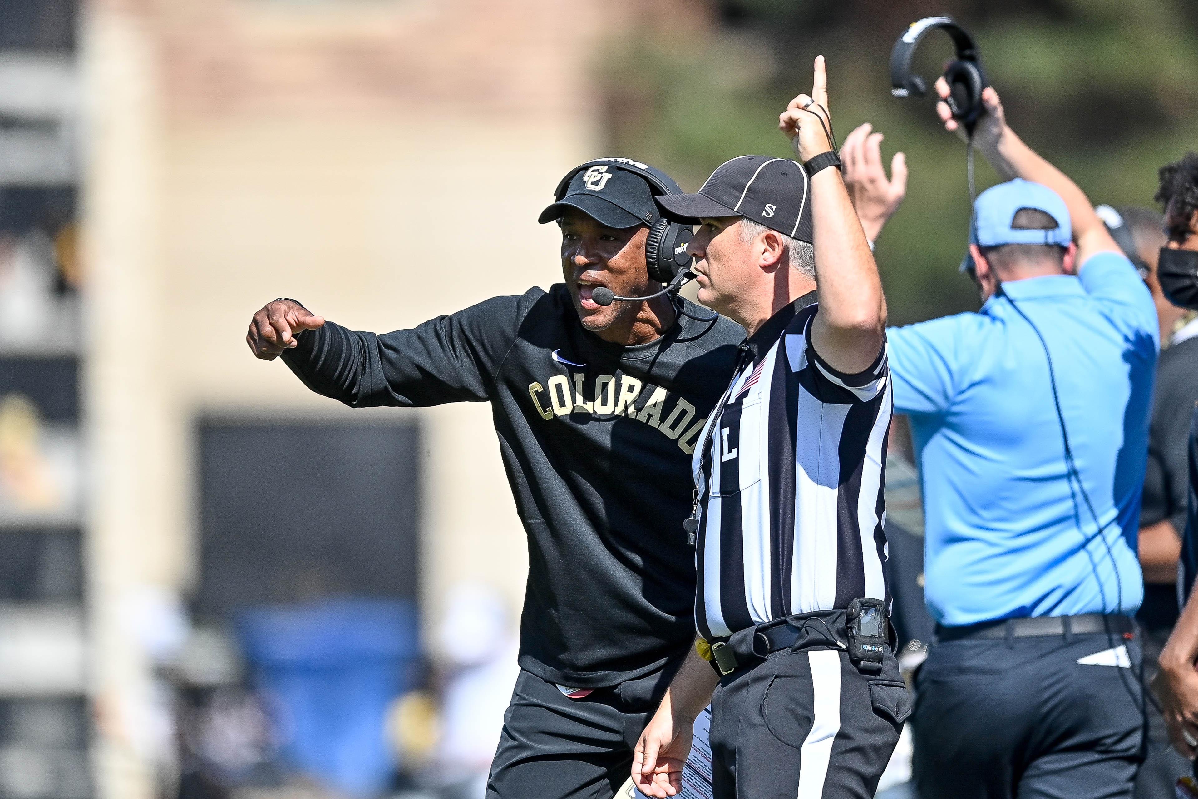 Colorado football coach Karl Dorrell smacks camera after Buffaloes  blowout loss to USC
