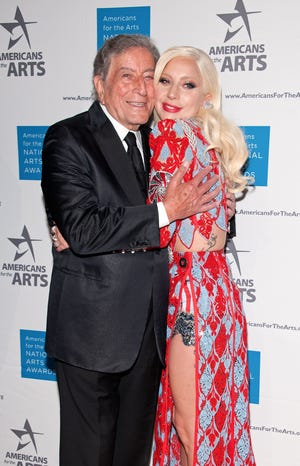 Tony Bennett and Lady Gaga walk the red carpet at the 2015 National Arts Awards in New York.